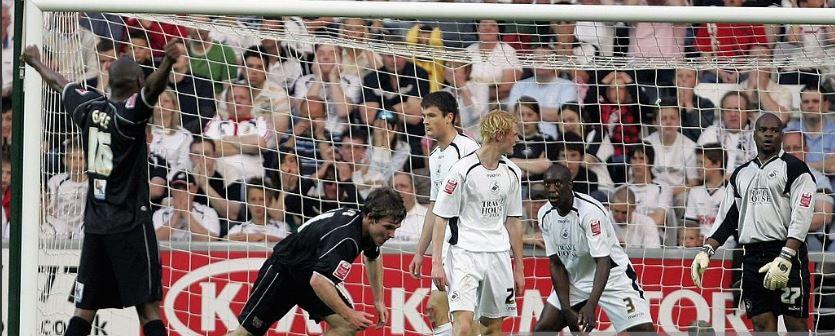 Jay Tabb celebrates after scoring at Swansea